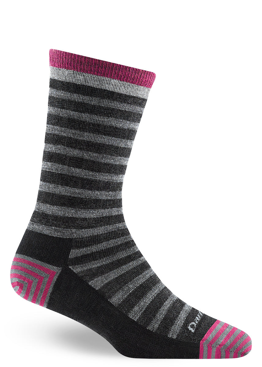 Wool socks for women feature a light gray and charcoal striped pattern with dark pink accents.