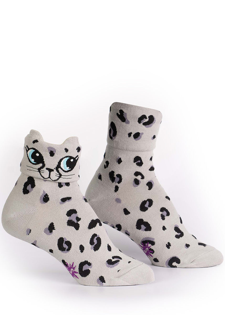 "Leopard pattern socks for women say ""Check meowt"" or cuff down to reveal a cat face."