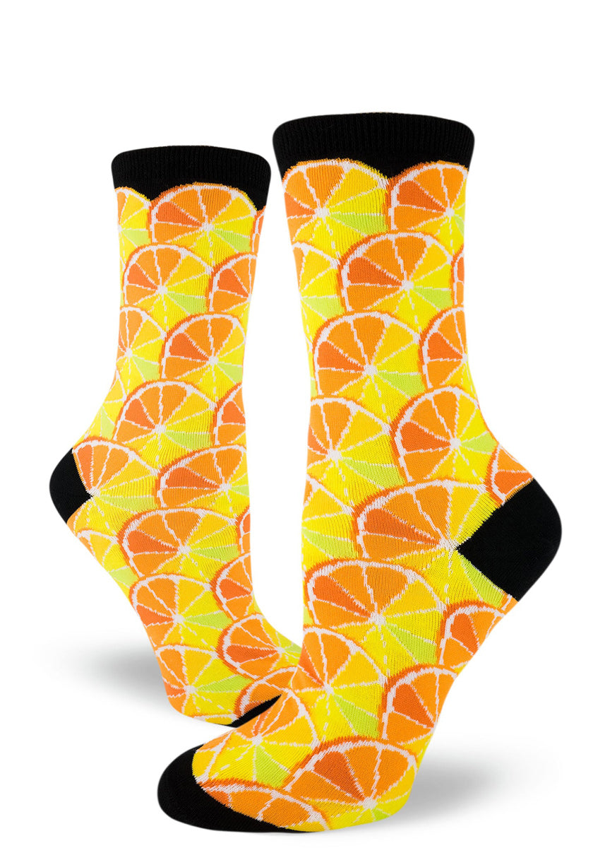 Citrus socks for women with slices of citrus with segments colored like limes, lemons, oranges and grapefruit