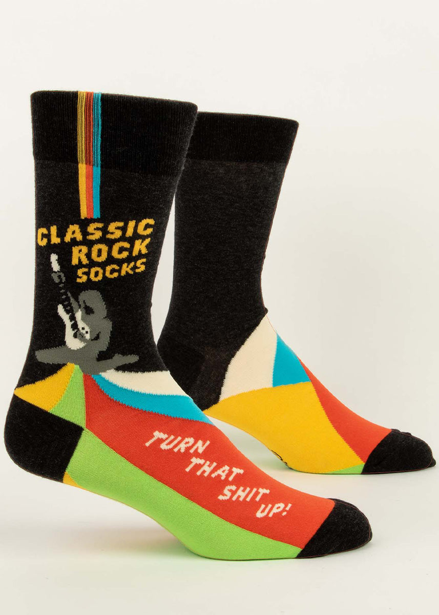 "Funny music socks for men show someone rocking out on a guitar with the words, ""Classic Rock Socks,"" and ""Turn that shit up!"""
