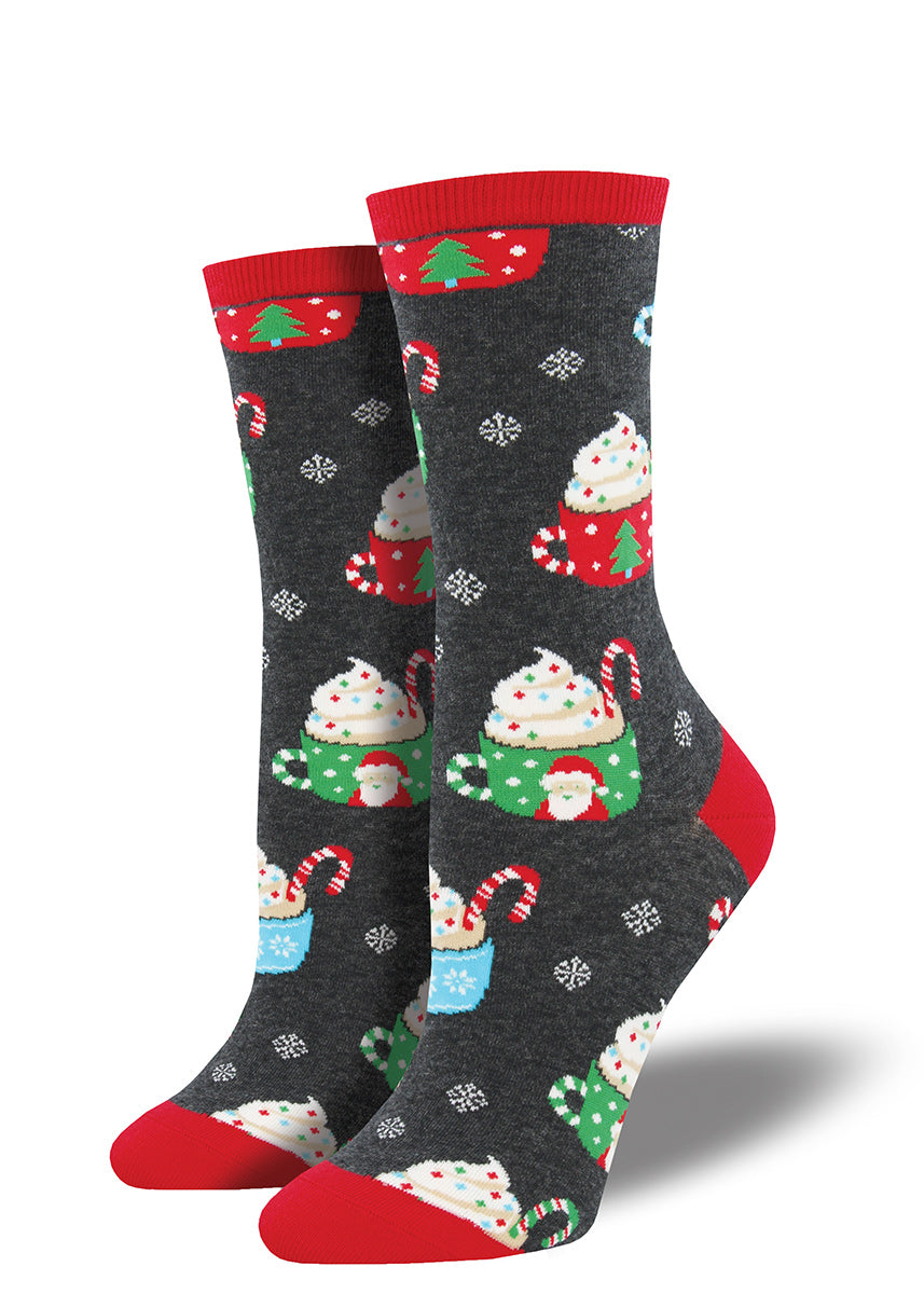 Christmas mugs of hot cocoa with whipped cream decorate these cute wintry women's socks.