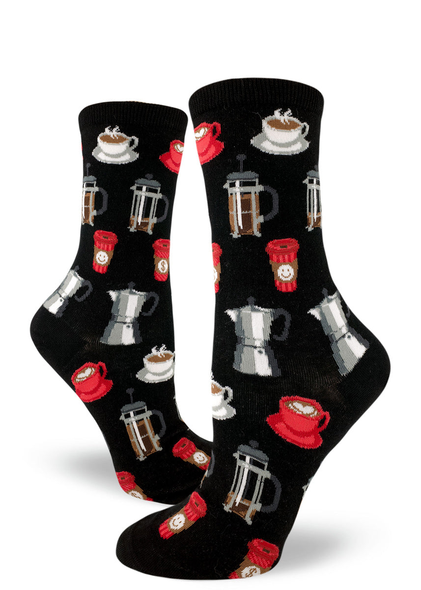 Coffee socks for women with French press coffee pots, cups of coffee and to-go cups of coffee on a black background
