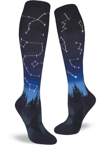 Constellation knee-high socks for women with stars in the blue night sky showing over the trees