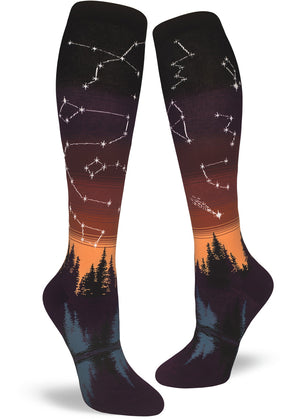 Night sky socks for women with constellations and lucky stars on a sunset background.