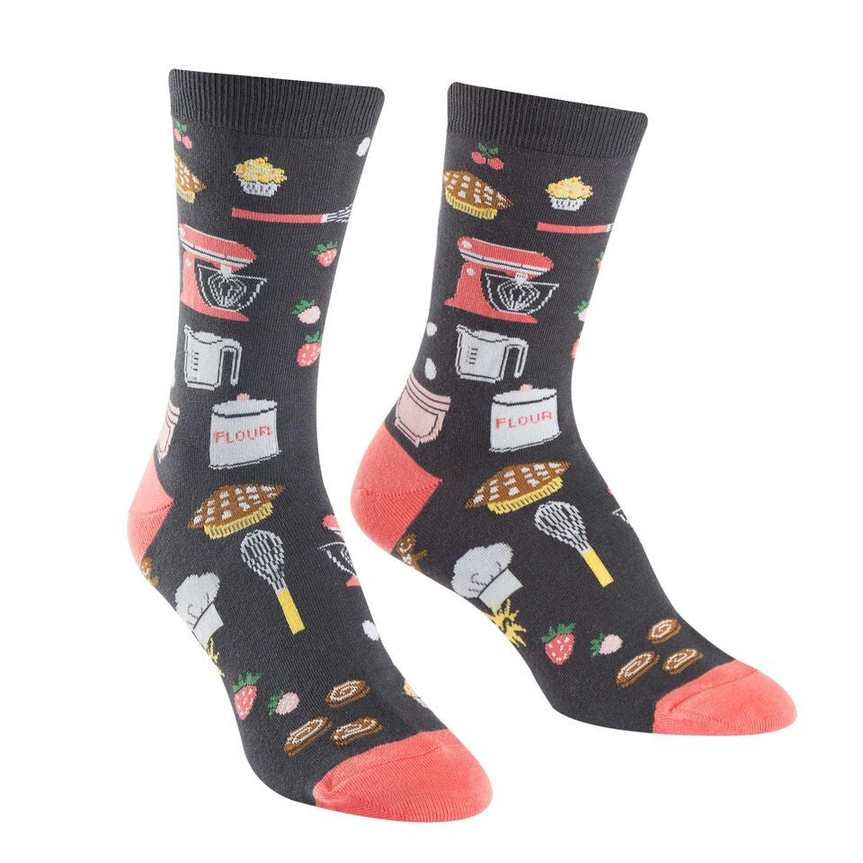These cooking socks for women are covered with baking supplies like mixers, whisks, eggs and other kitchen stuff