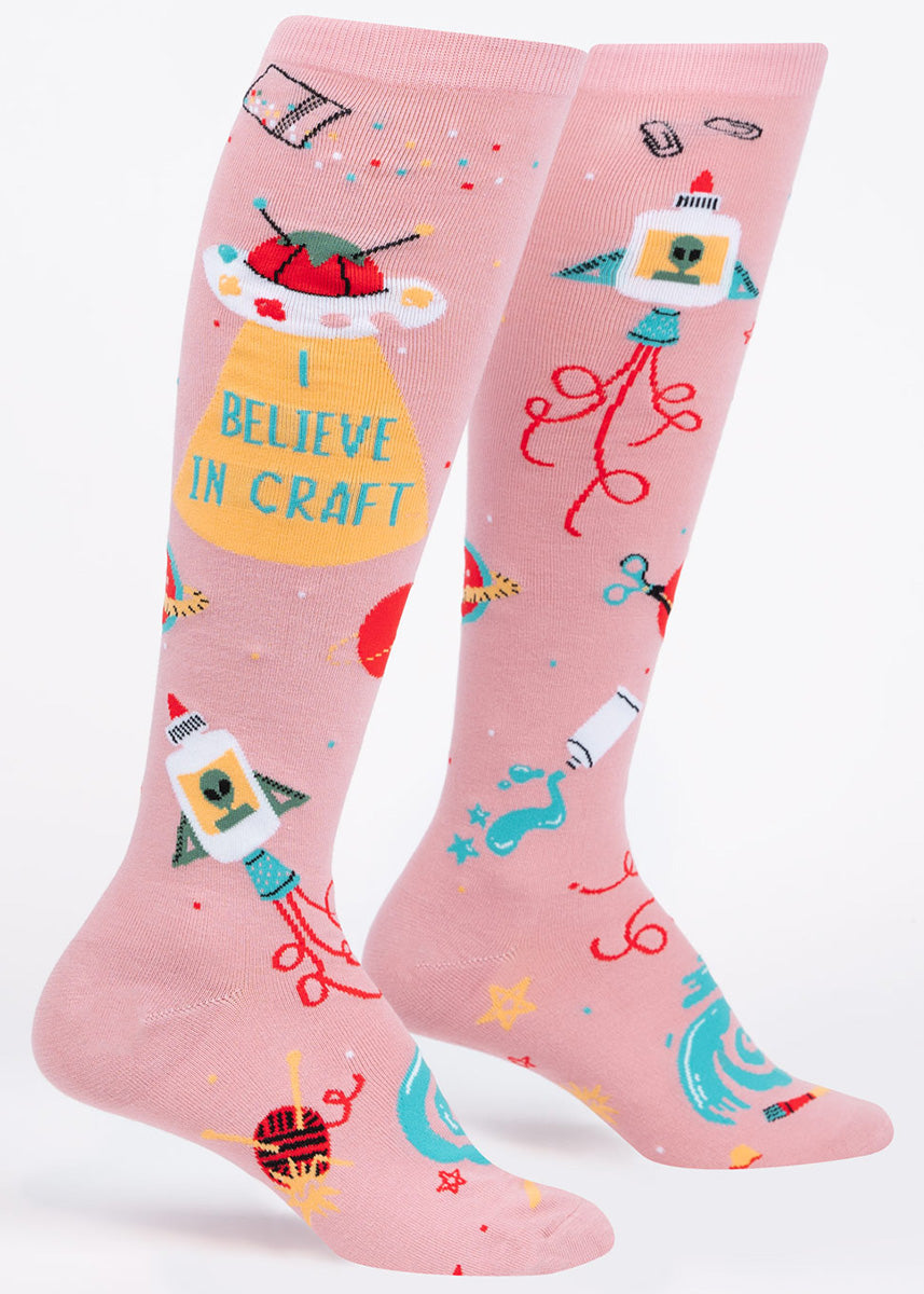 Funny knee-high socks for women feature spacecrafts made of actual craft supplies; including glue-tube-rockets and UFO pincushions!