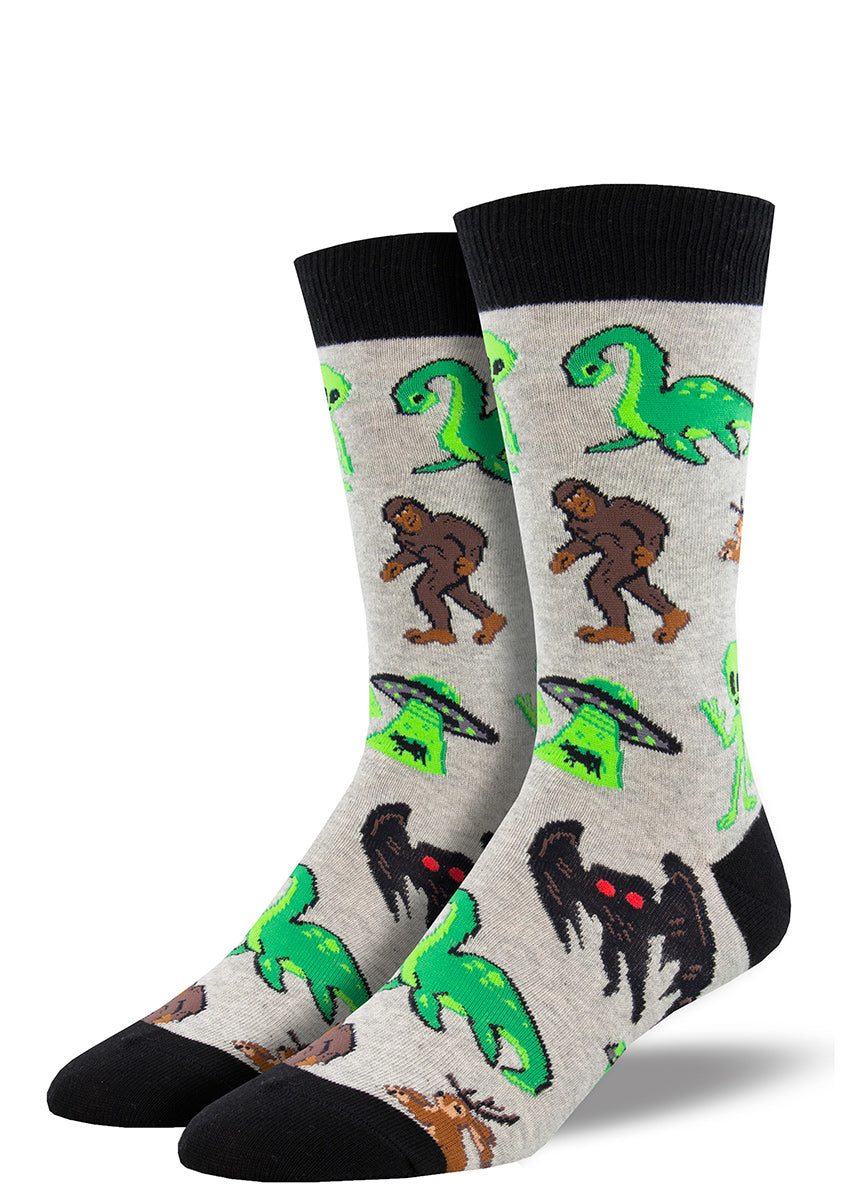 Cryptid socks for men feature Nessie, Bigfoot, Mothman, a jackalope, and a UFO.