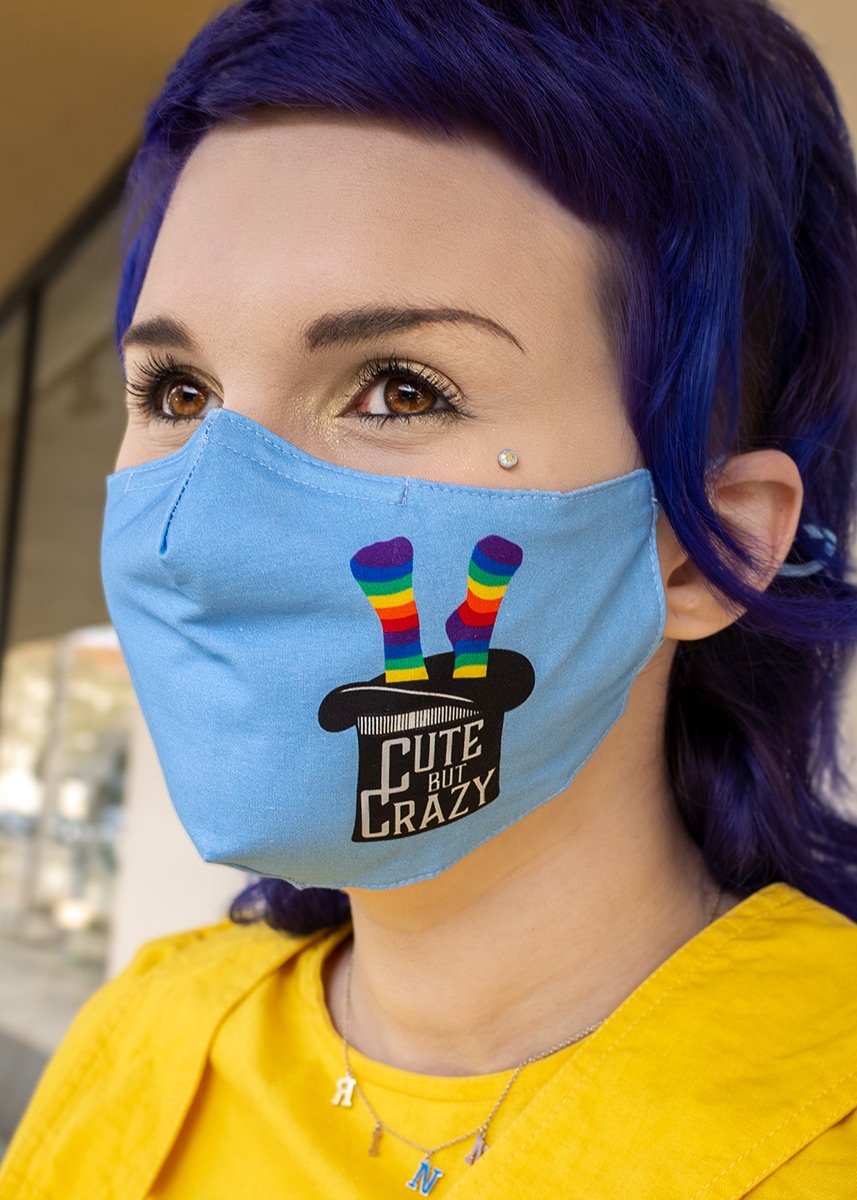 "Face mask for adults features an upside down top hat with the words ""Cute but Crazy"" and rainbow socks coming out the top!"