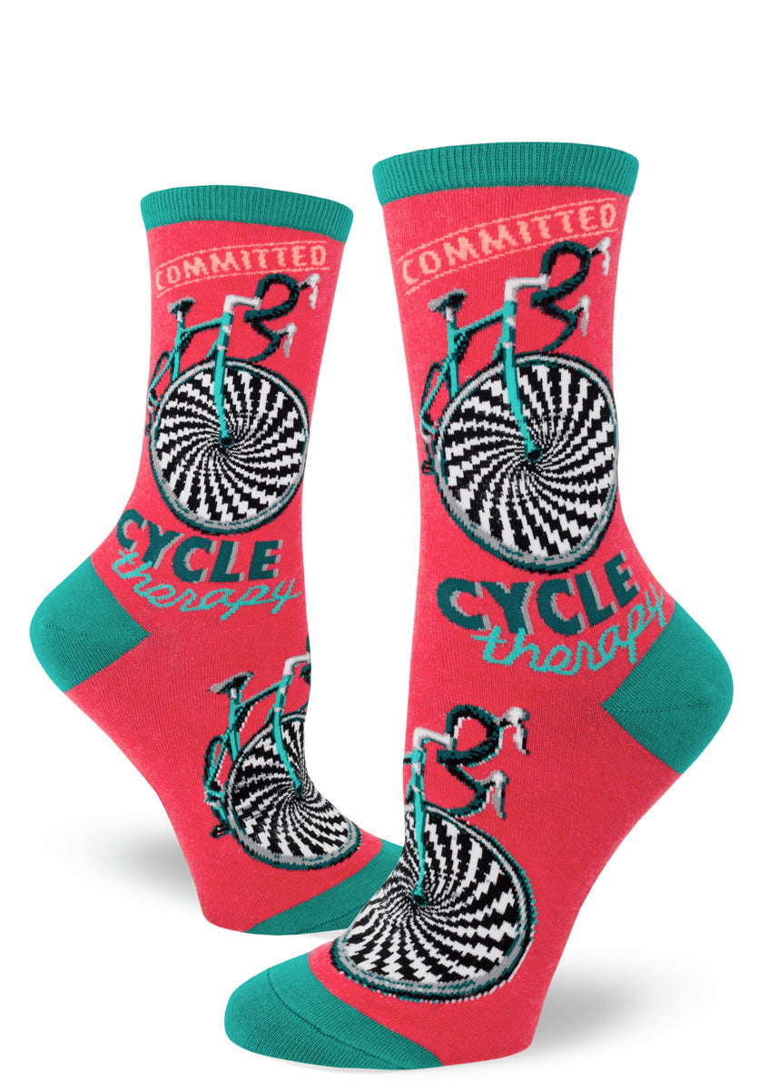 "Bicycle socks for women that say ""Cycle Therapy"" on a red background"