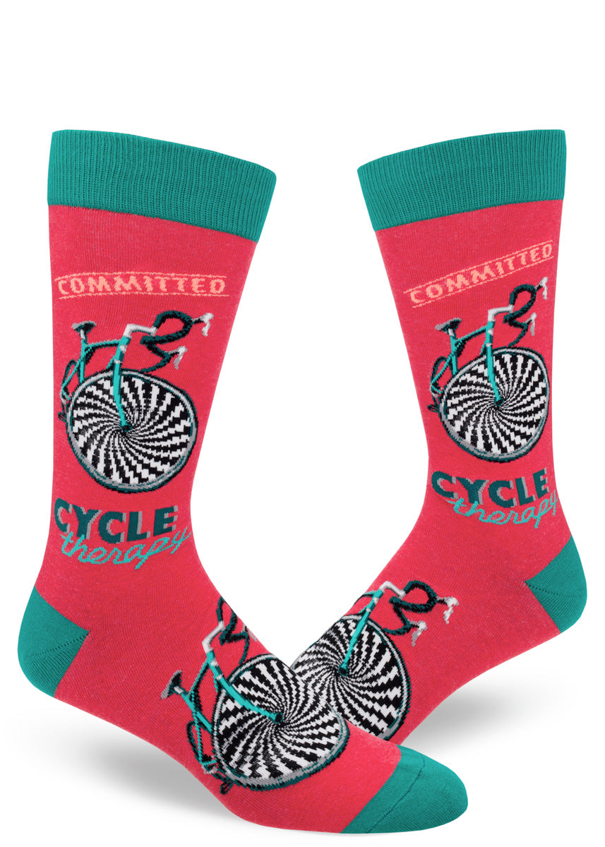 "Bicycle socks for men with the words ""Cycle Therapy"" and ""Commited"" on a red background"