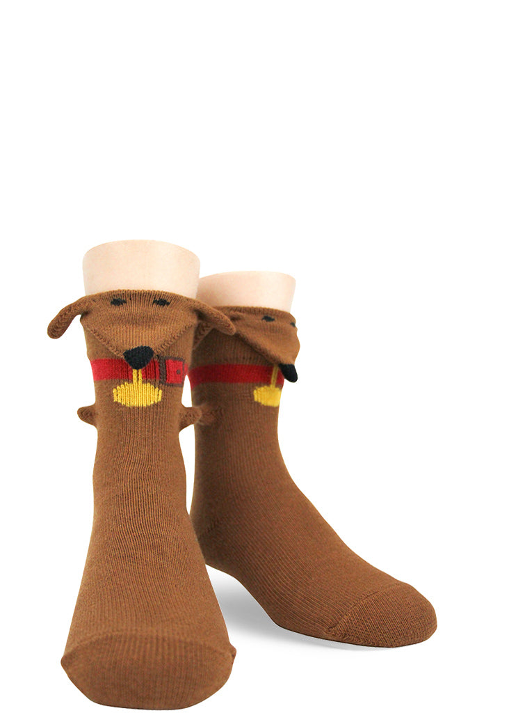 Funny 3d dachshund dog socks for kids with a dimensional wiener dog looking out over the top.