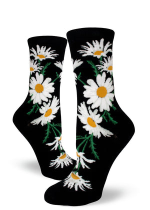 Daisy flower socks for women with white and yellow daisies on a black background