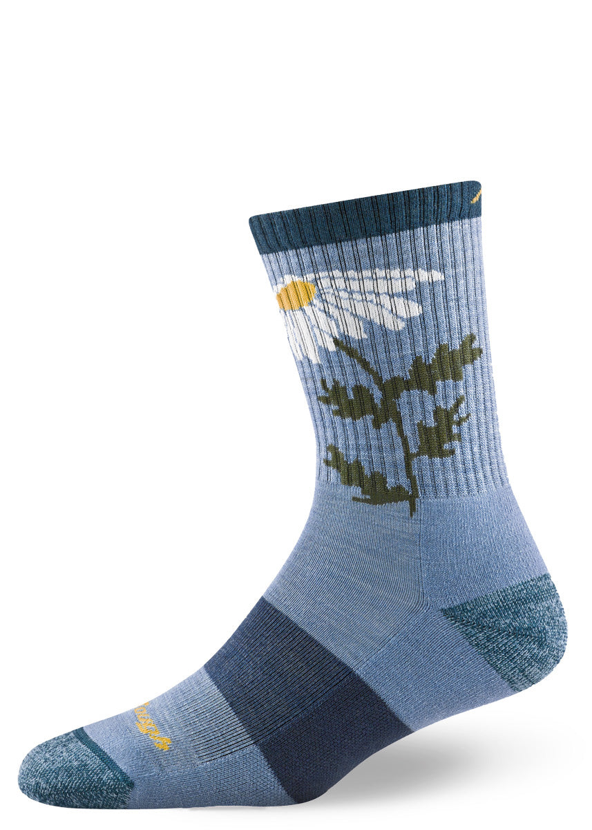 Cushioned wool socks for women feature a design of a white daisy and a bumblebee on a light blue background.