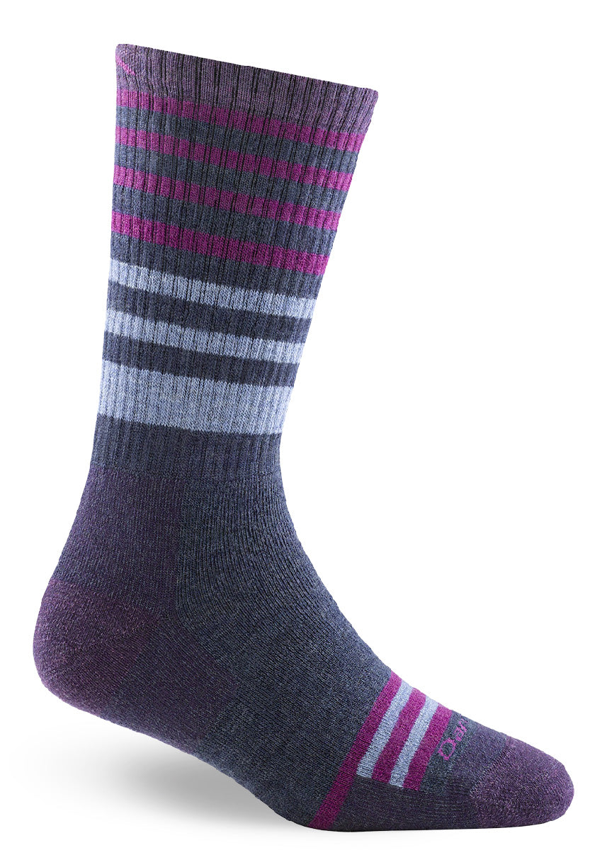 Cushioned wool boot socks for women with magenta stripes on a purple background.