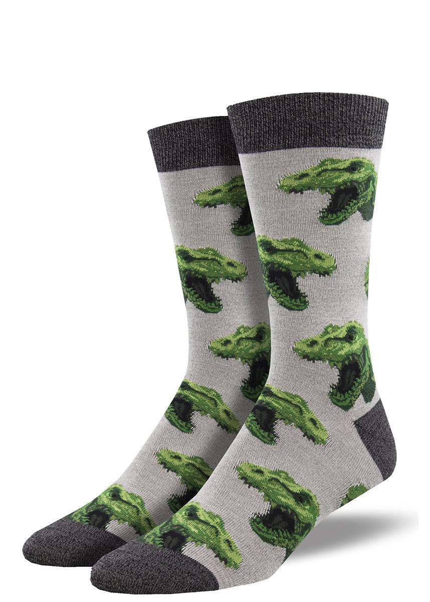 Bamboo crew socks for men feature roaring green T-Rex heads on a light gray background.