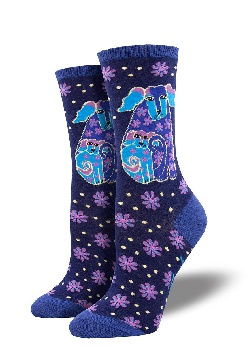 Laurel Burch socks for women show a mama dog and her puppy in tones of blue and purple.