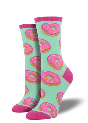Donut socks for women with frosted donuts with pink sprinkles on a mint green background
