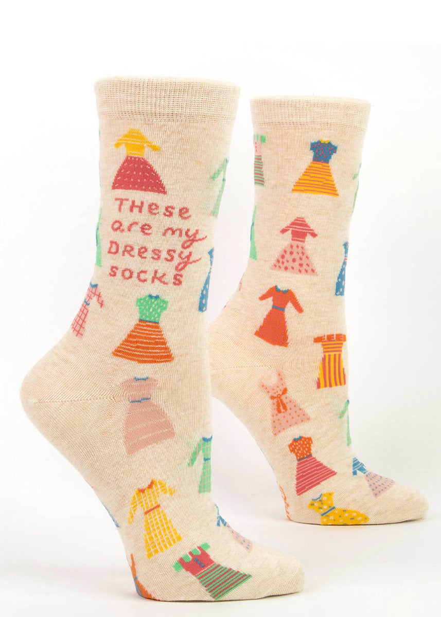 "Funny crew socks for women are covered in colorful pattered dresses with the words, ""These are my dressy socks."""