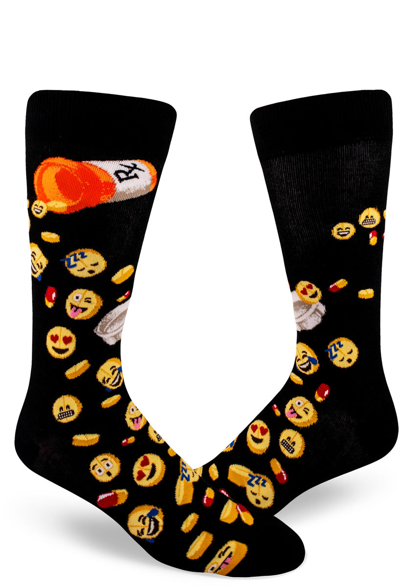 Medical emoji socks for men with cute yellow emoji face pills spilling out of a pill bottle on a black background