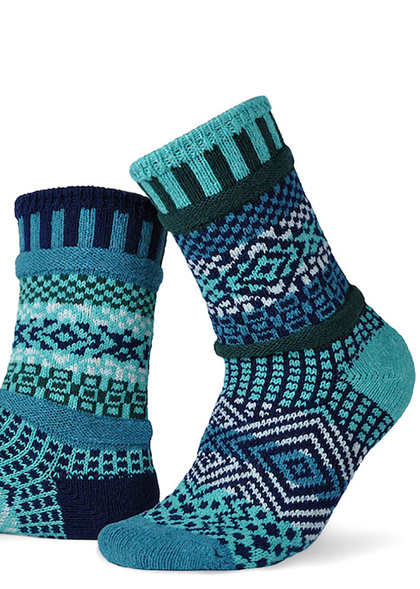 Mismatched socks from Solmate Socks in Evergreen pattern with blue and green