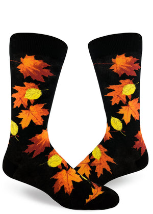Fall leaves socks for men with orange, red and yellow leaves on a black background