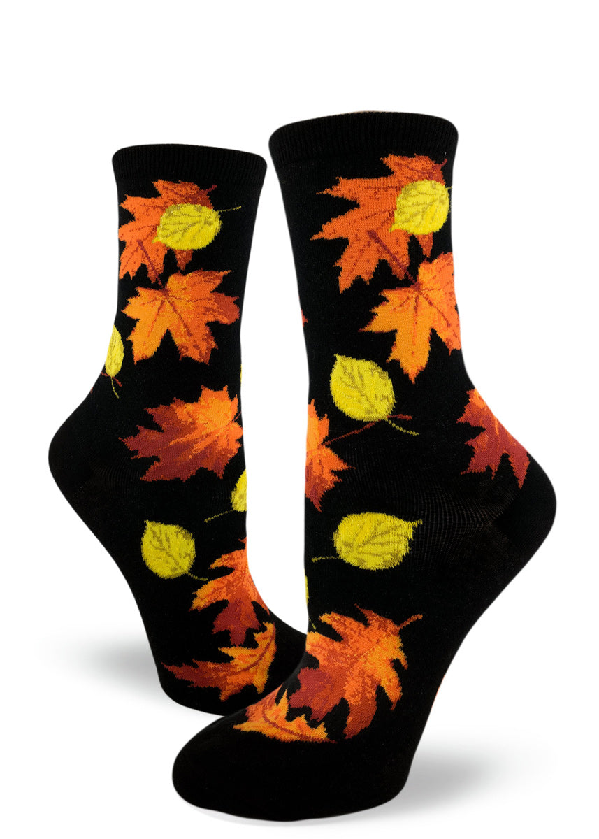 Fall leaves socks for women with orange and yellow autumn leaves on a black background