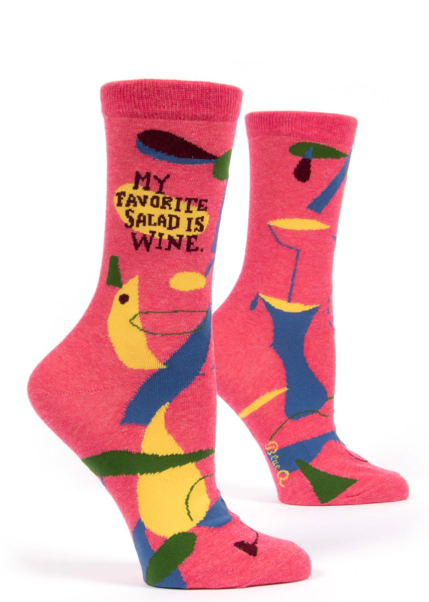"An intoxicating women's crew sock with bold designs and the phrase ""My favorite salad is wine."""