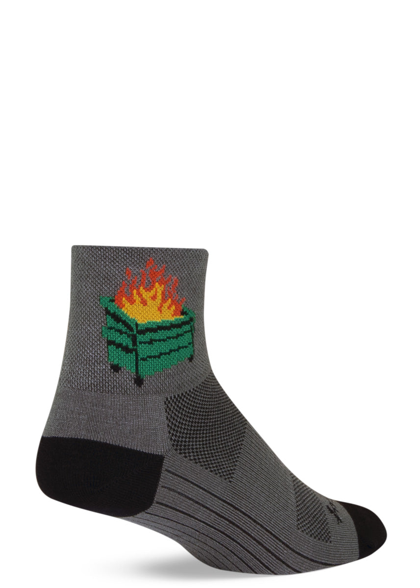 Funny athletic socks feature a just-above-ankle length and a design of a dumpster fire on a light gray background