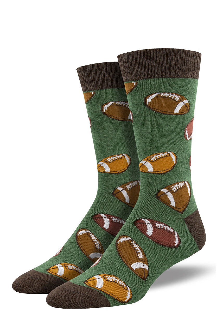 Bamboo crew socks for men feature a design of brown footballs on a green background.