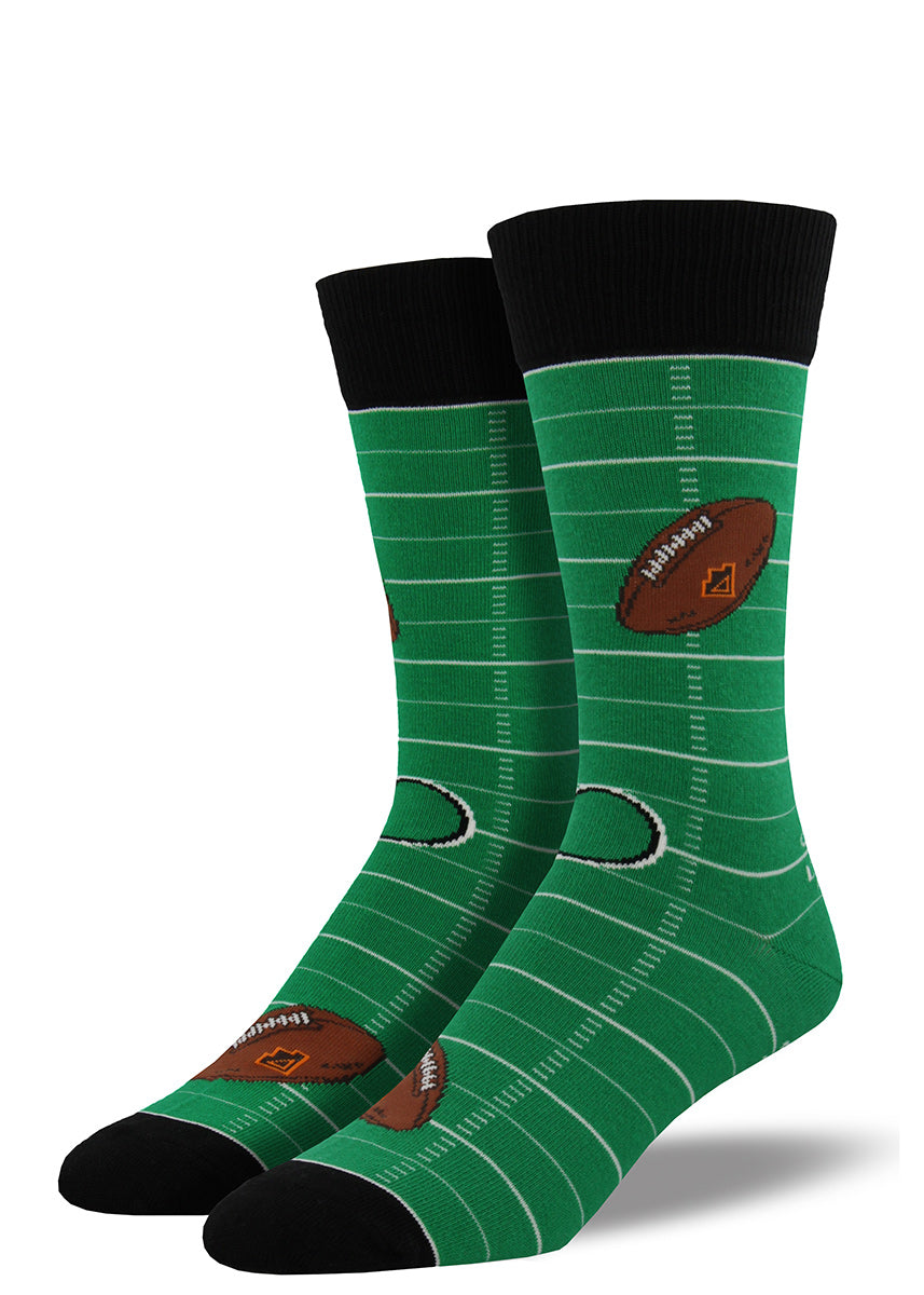 Football socks for men with footballs and a football field