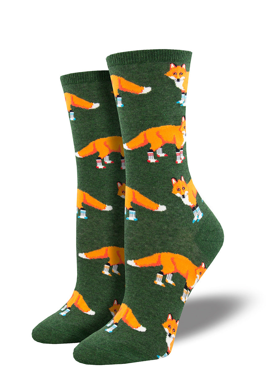 Crew socks for women show orange foxes wearing socks on all four legs.