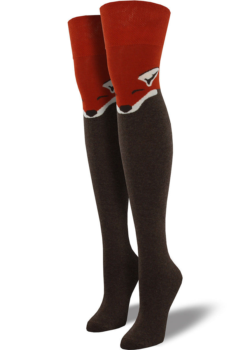 Over-the-knee-socks with cute fox faces at the knee in brown and red.