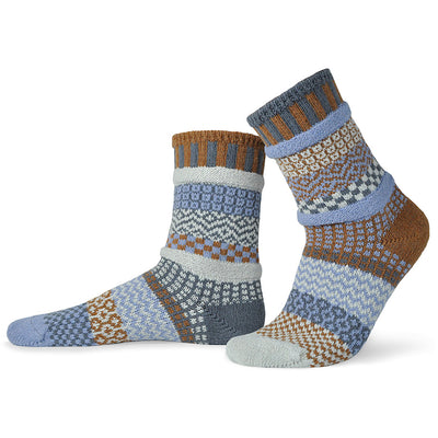 Cozy mismatched socks knit with light blue and brown yarn