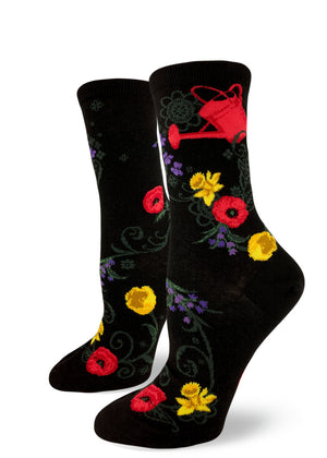 Gardening socks for women with flowers and a red watering can on a black background