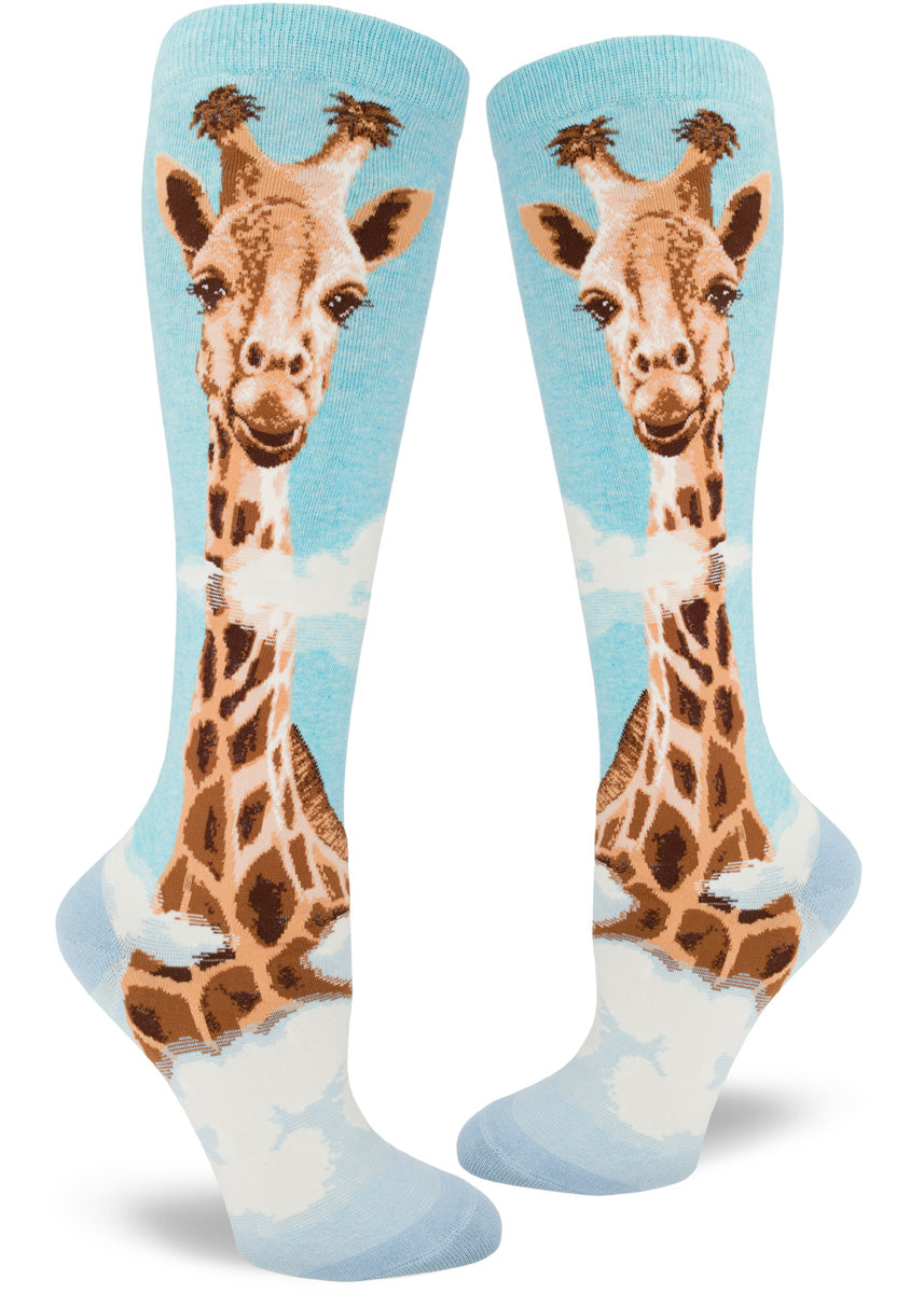 Knee-high giraffe socks for women with giraffe heads in the clouds