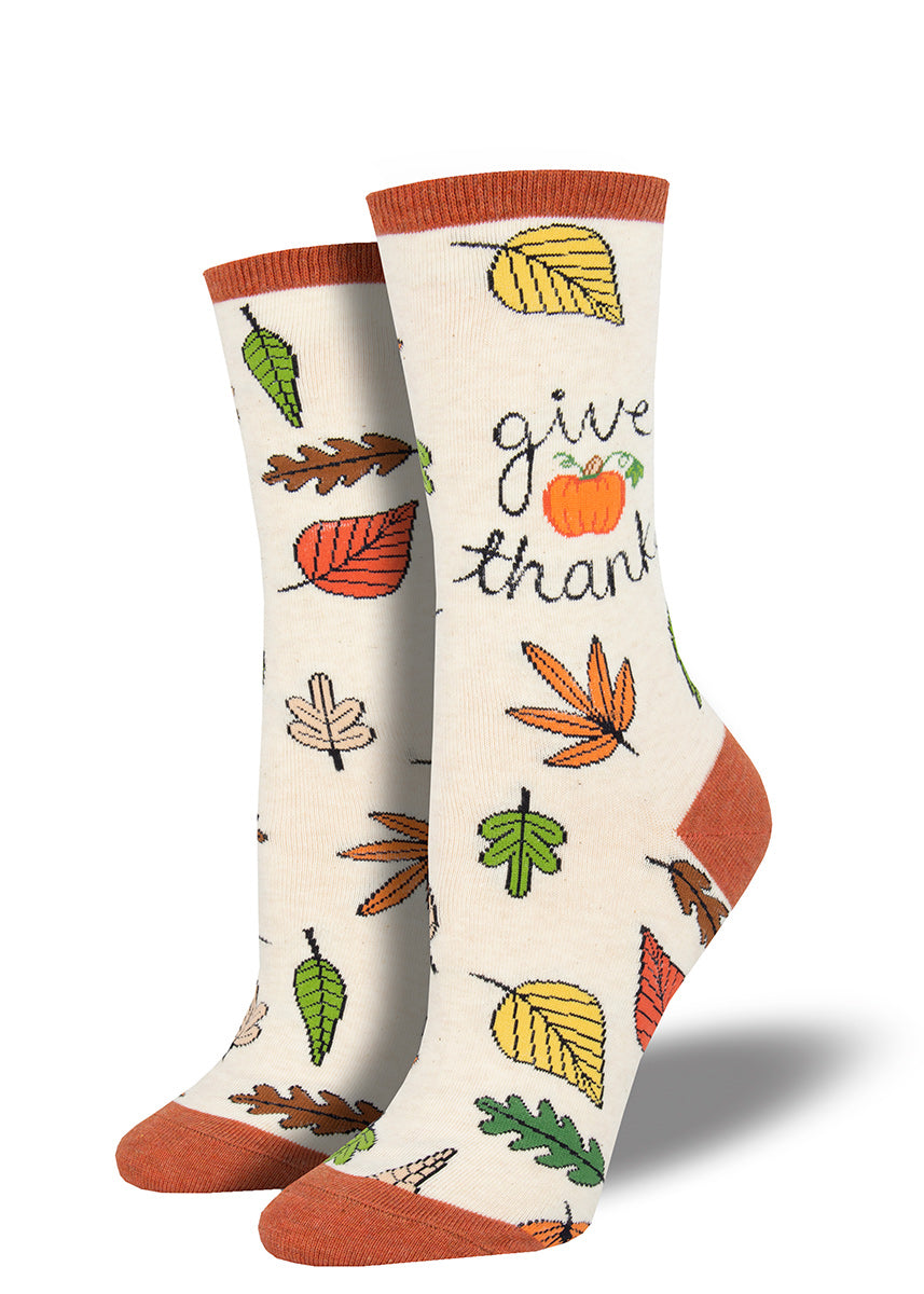 "Cute Thanksgiving socks for women with fall leaves and the words ""Give Thanks"""