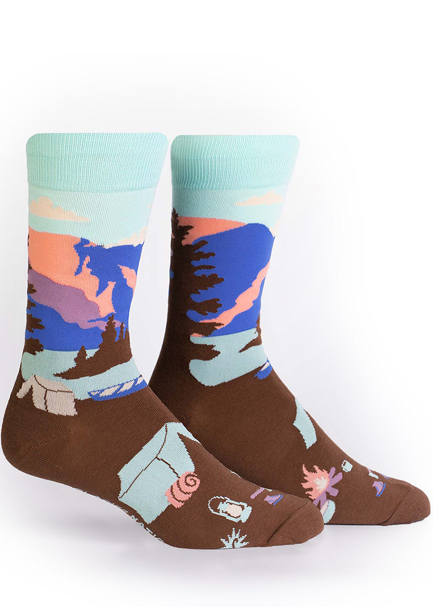 Glacier National Park socks for men show a tent and camping gear next to a lake with beautiful mountains in the background.