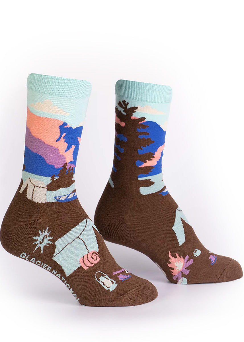 Camping socks for women show a tent and canoe next to a lake with glacier peaks in the background.