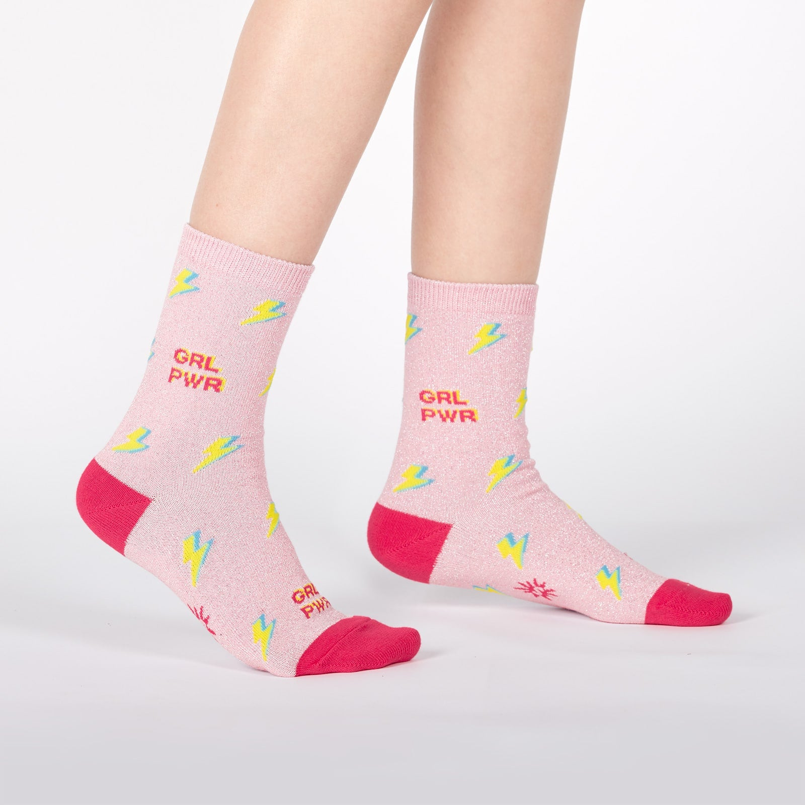 "Pink sparkly kids' socks with lightning bolts and the words ""GRL PWR"" (Girl Power)"