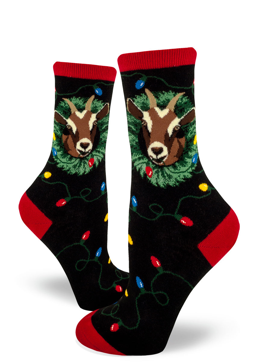 Christmas goat socks for women with goats eating Christmas decorations like wreaths and Christmas lights