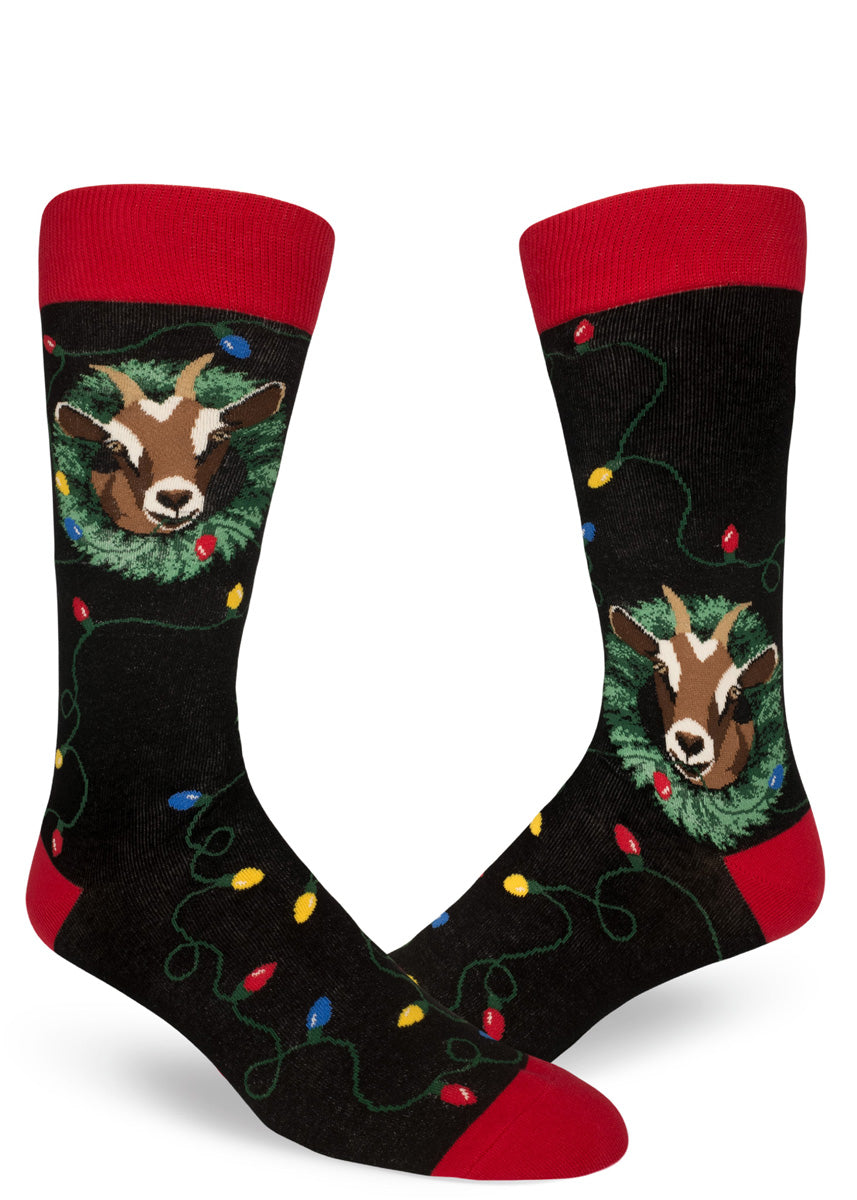 Goats eat Christmas lights on our funny men's Christmas socks in black and red.