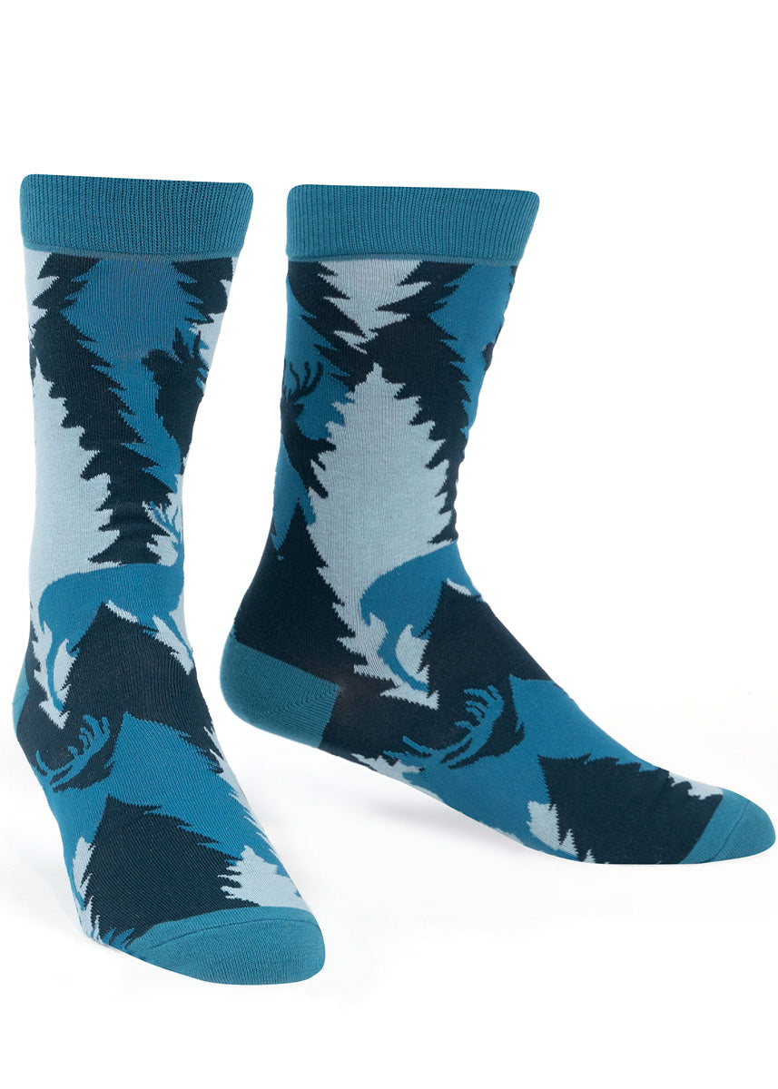Nature crew socks for men show a stag in the woods at night.