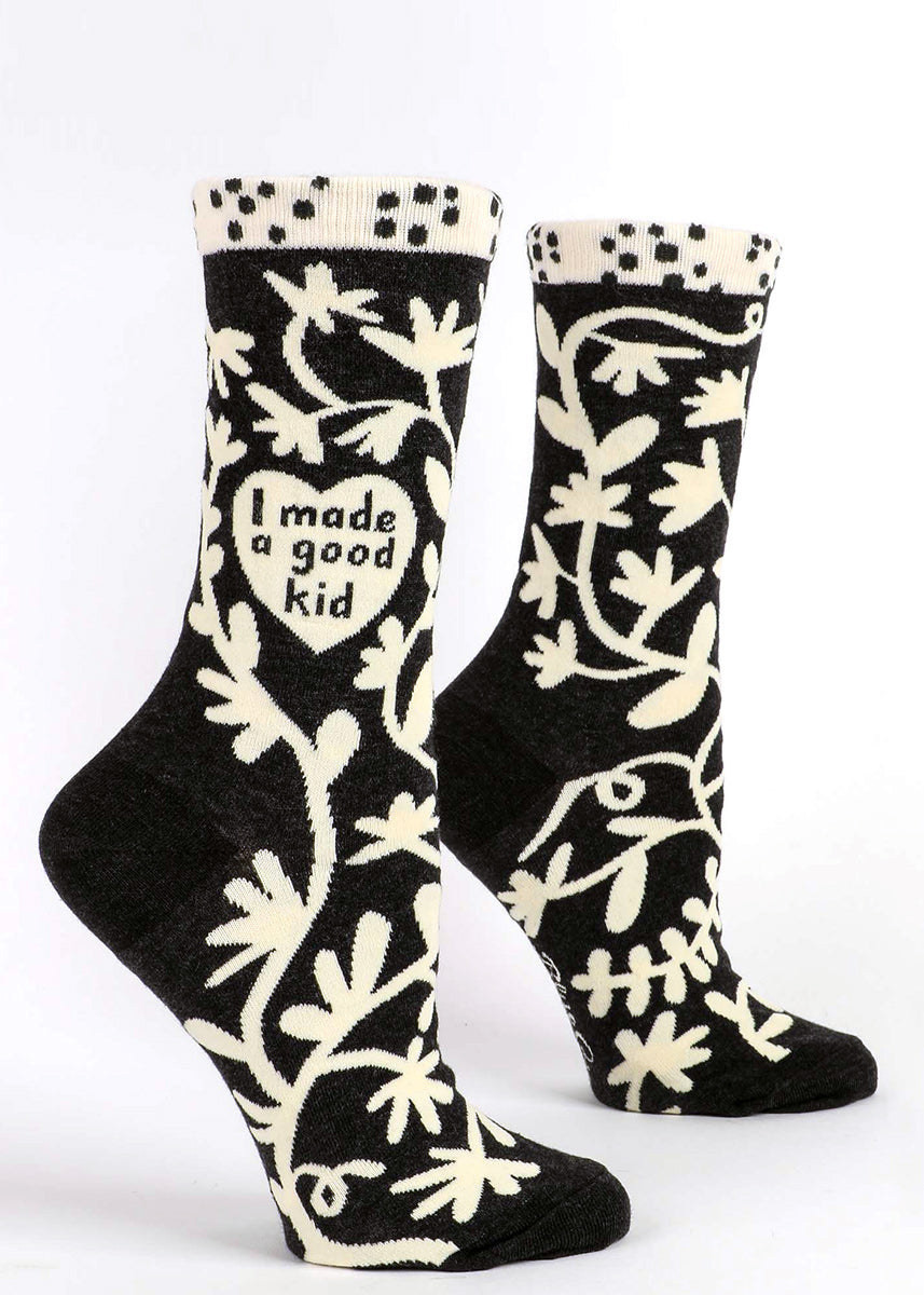 "Funny mom socks for women feature a cream and black floral design with the words ""I made a good kid"" inside a heart!"