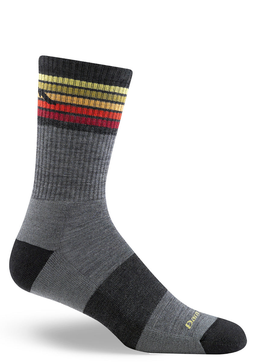 Wool hiking socks for men with colorful stripes at the top and a cushioned sole for added comfort