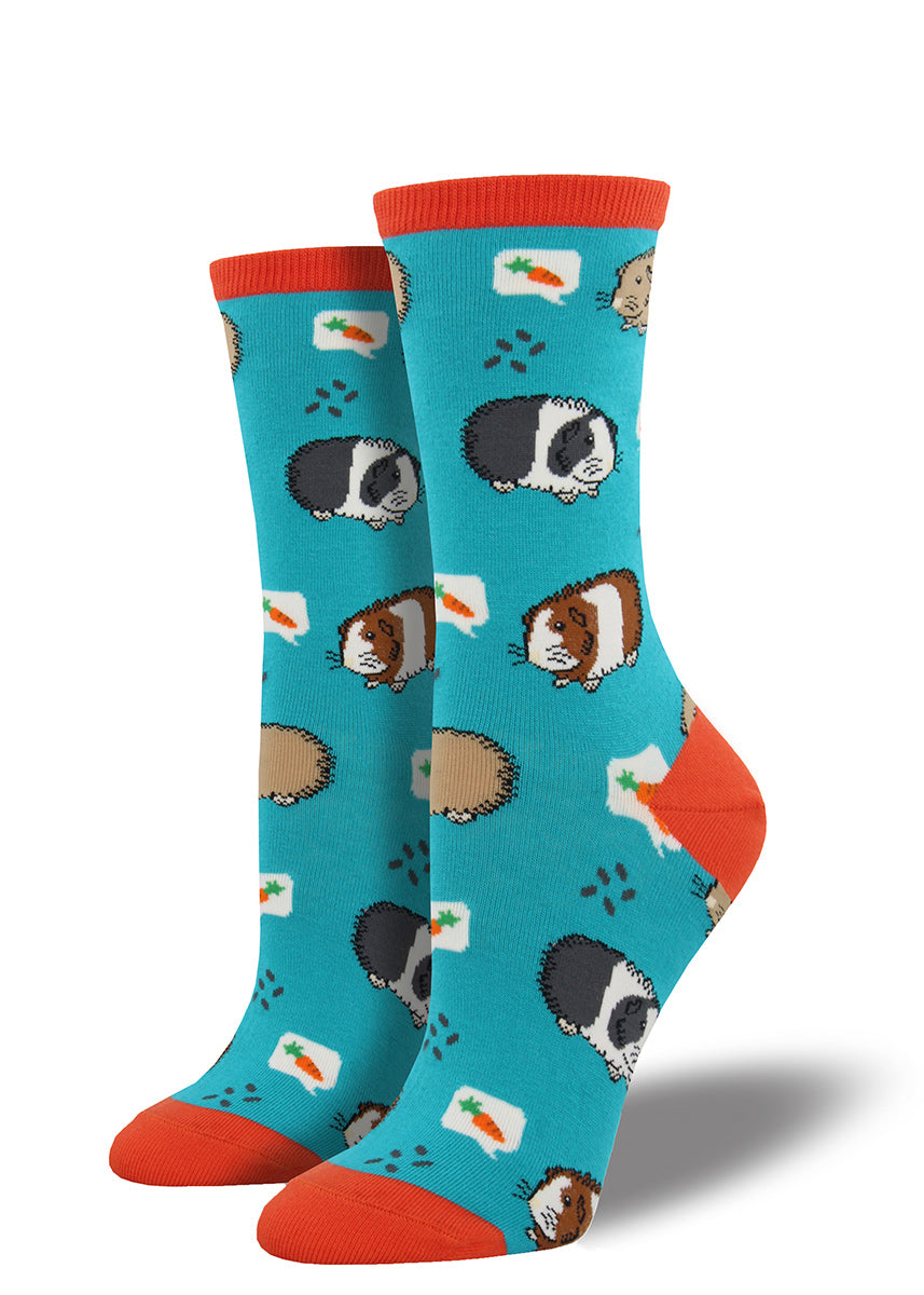 Adorable guinea pigs set against turquoise and bright orange decorate these women's crew socks.