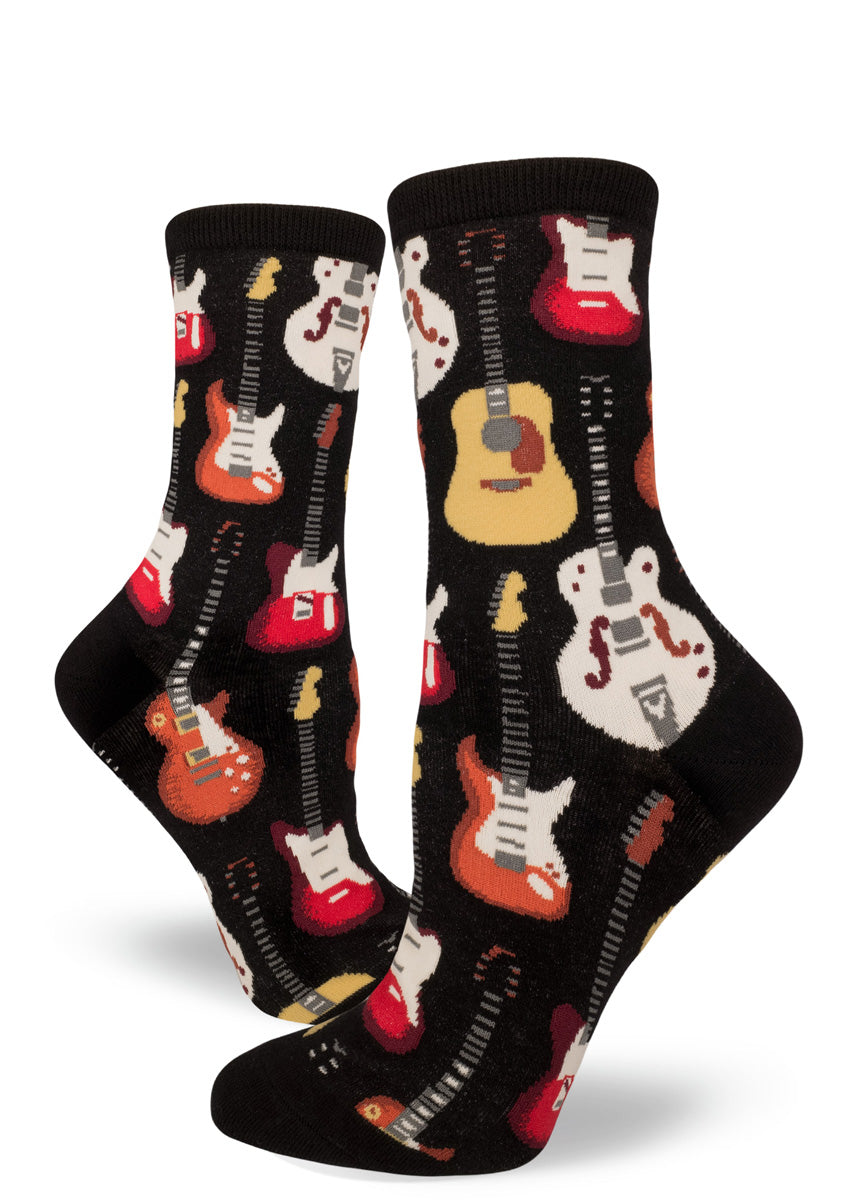 Women's socks with guitars on a black background.