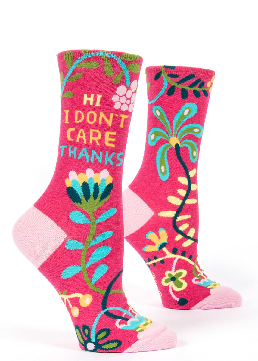 "Funny women's socks that say ""HI I DON'T CARE THANKS"" with a pink floral design."
