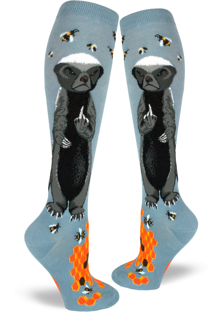Funny knee-high honey badger socks for women with badgers flipping the middle finger and bees with honeycombs