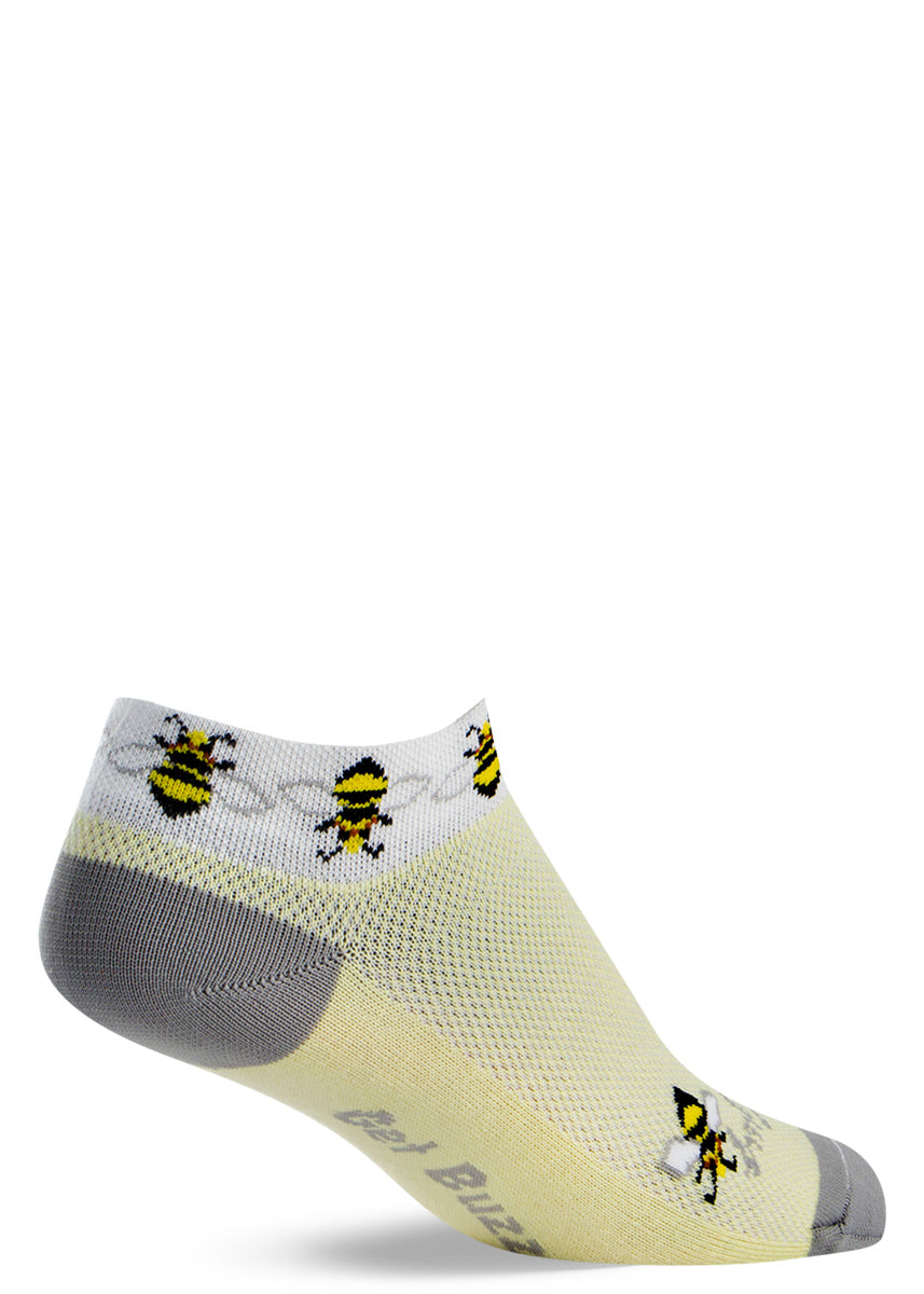 "Cute bee ankle socks for women with honeybees on light yellow socks with the words ""Get buzzy"" on the bottoms of the feet"