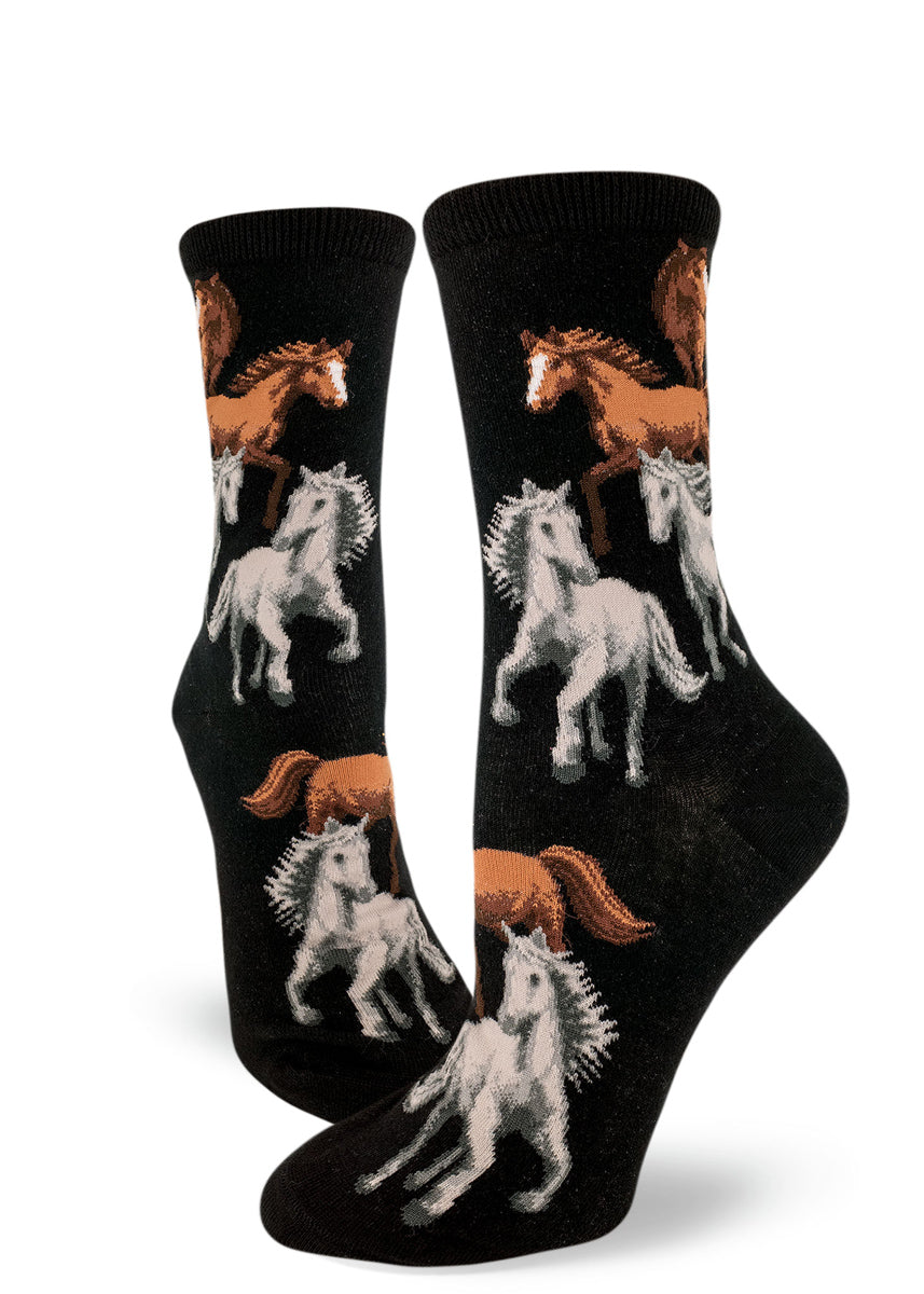 Horse socks for women with wild stallions running free on a black background